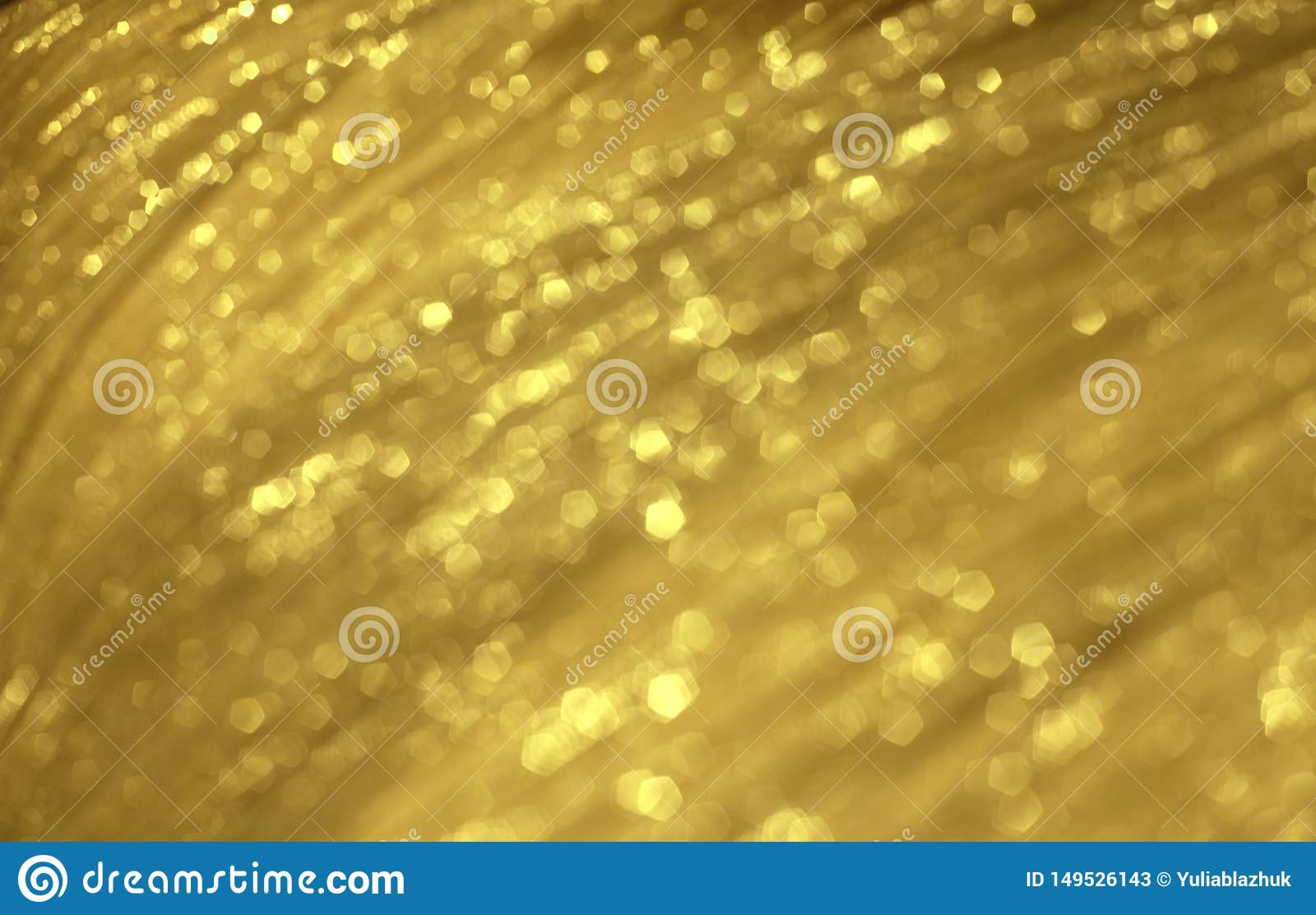 Shiny golden festive blurred tissue texture. Abstract glowing backdrop.