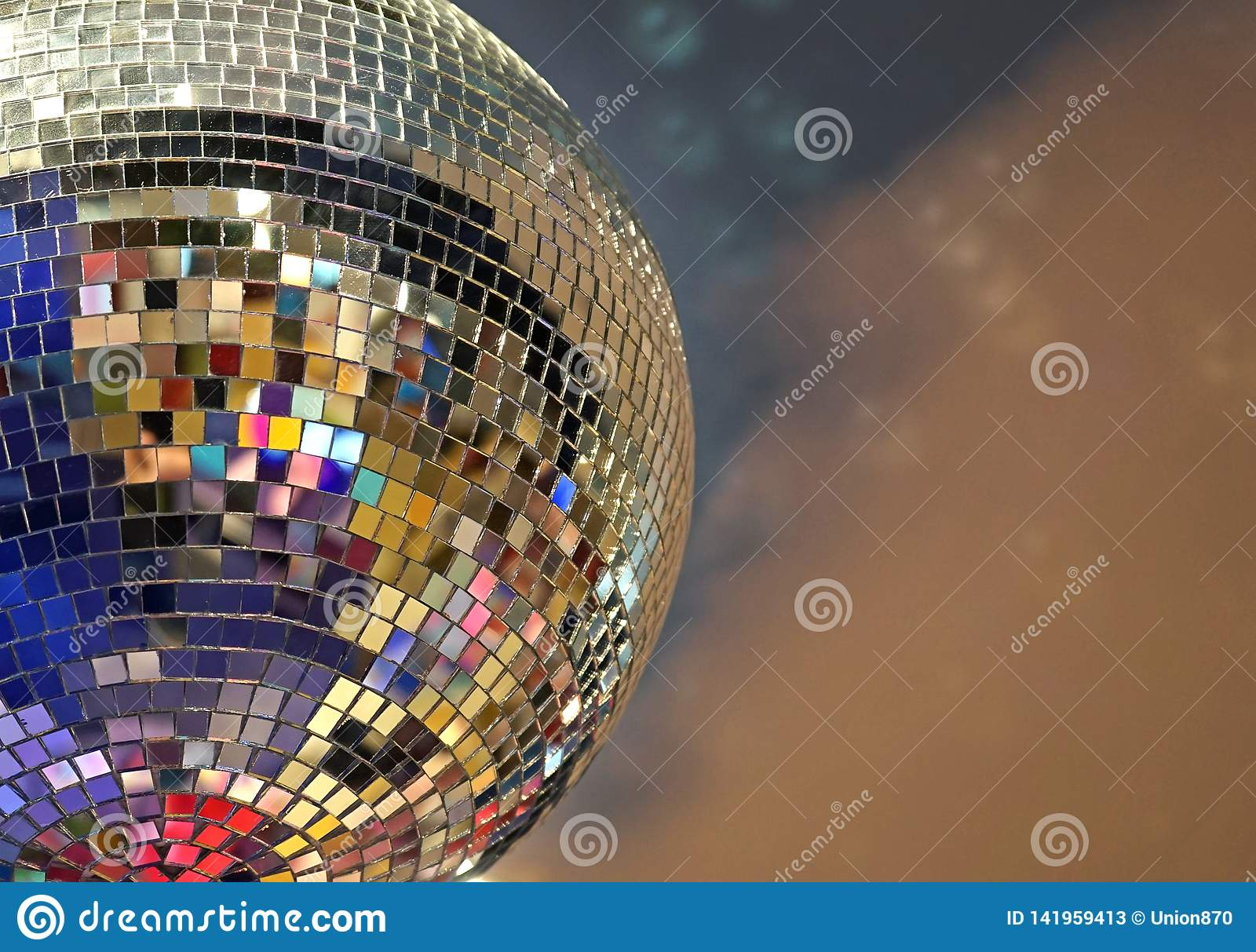Shiny mirror ball with colorful highlights at the disco
