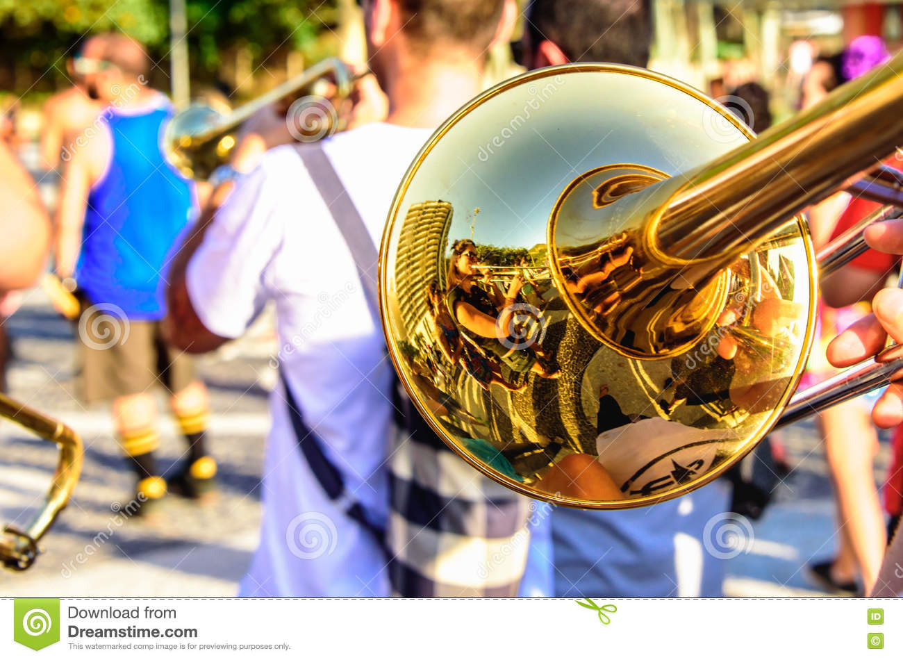 Shiny trombone and blurry musicians playing catchy music at Leme district, Rio de Janeiro, Brazil