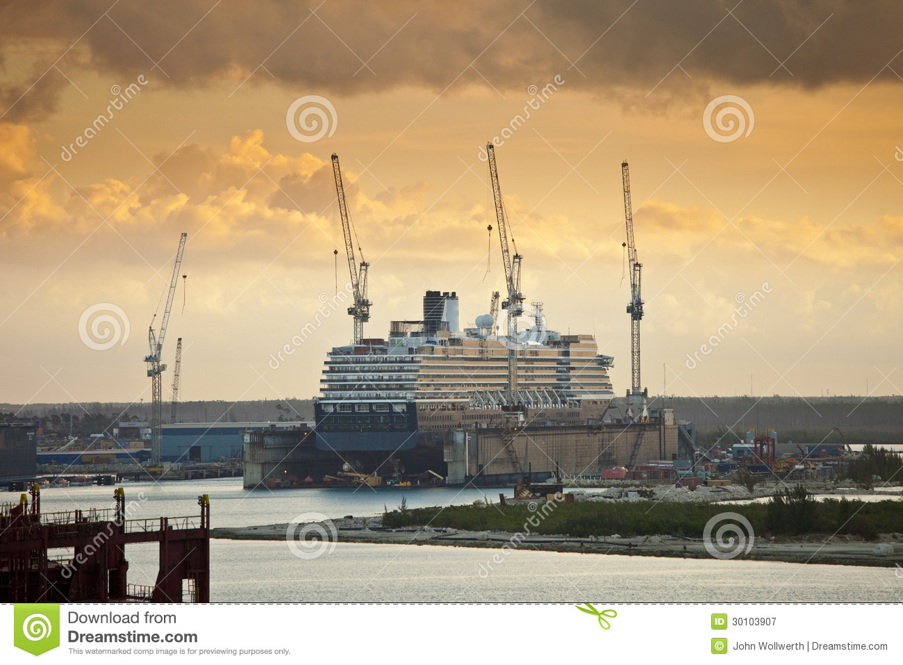 Ship being repaired in dry dock royalty free stock photography image