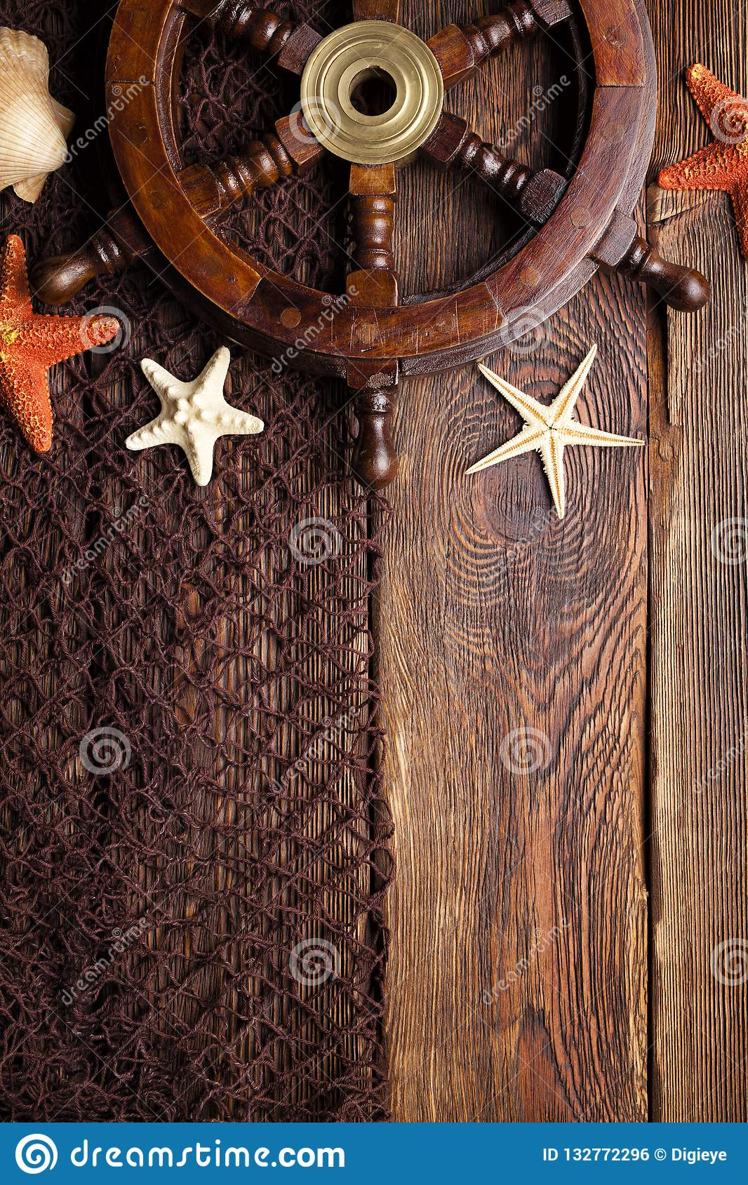 Ship S Steering Wheel Starfish And Fishing Net On Wooden Table Stock Photo Image Of Boat Wood 132772296