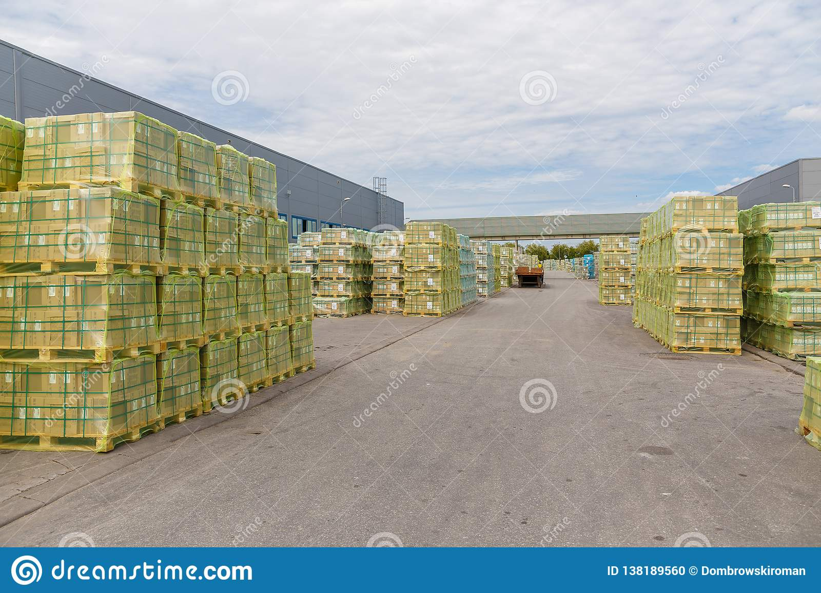 Shipment, logistics, delivery and product distribution-business industry. Storage warehouse with cardboard boxes with packed goods