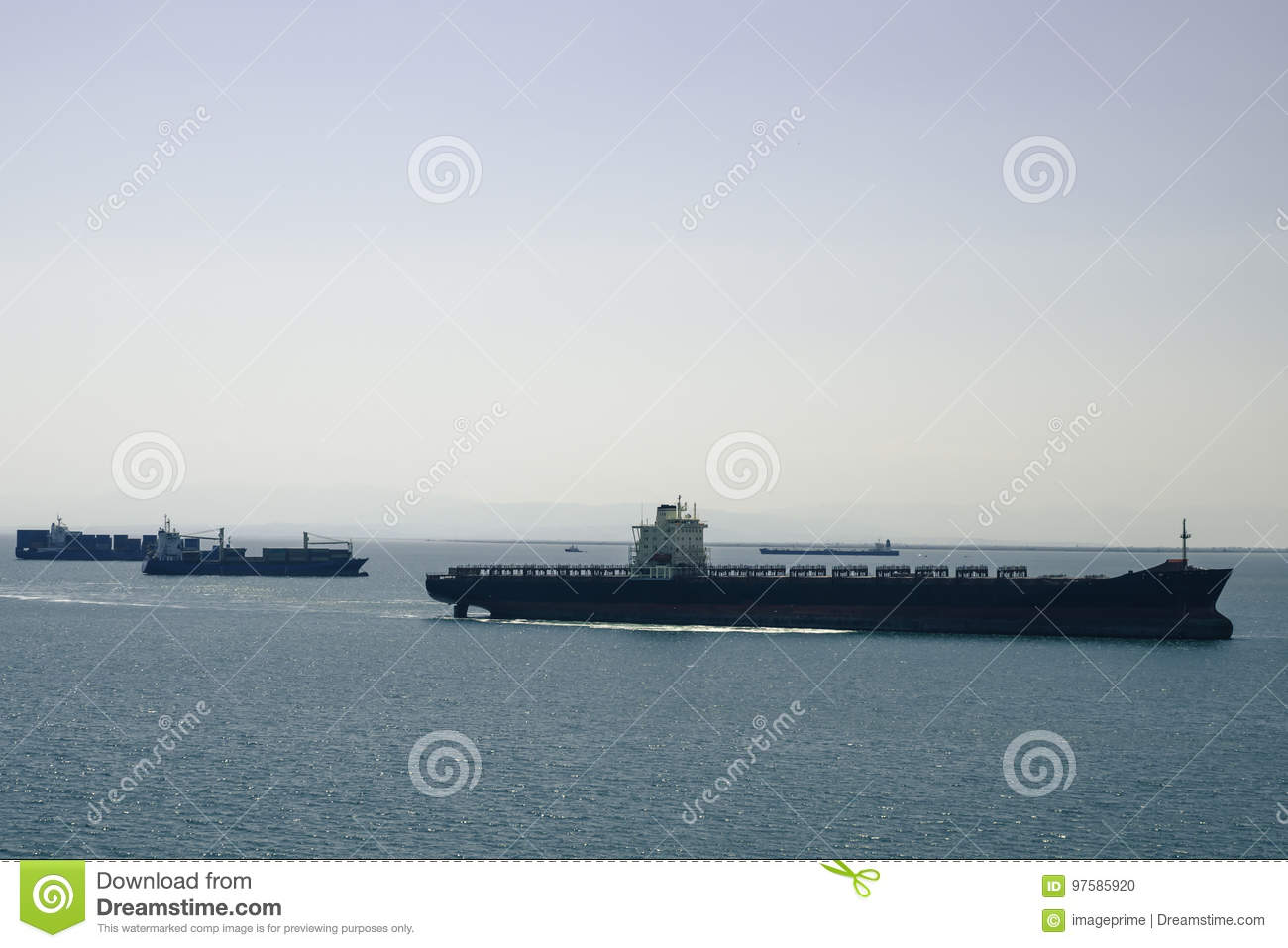 Shipping Container Vessels, Ship Convoy Aproaching Harbor Stock
