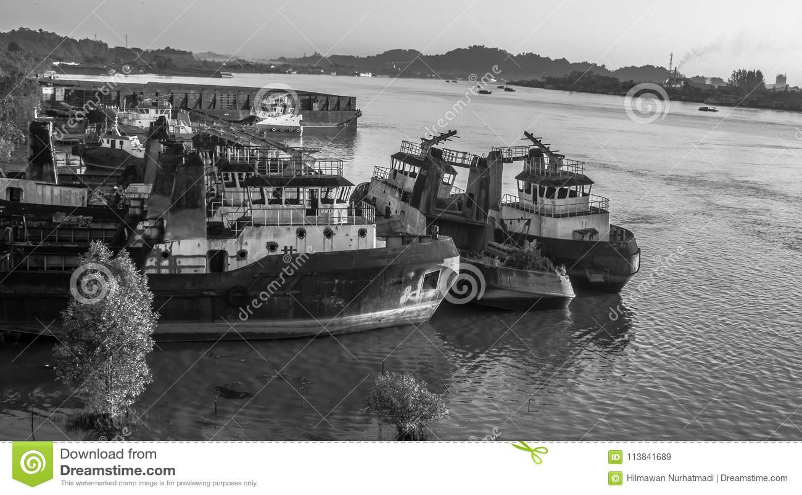 Shipping yard on Mahakam riverbank, Borneo, Indonesia black and white