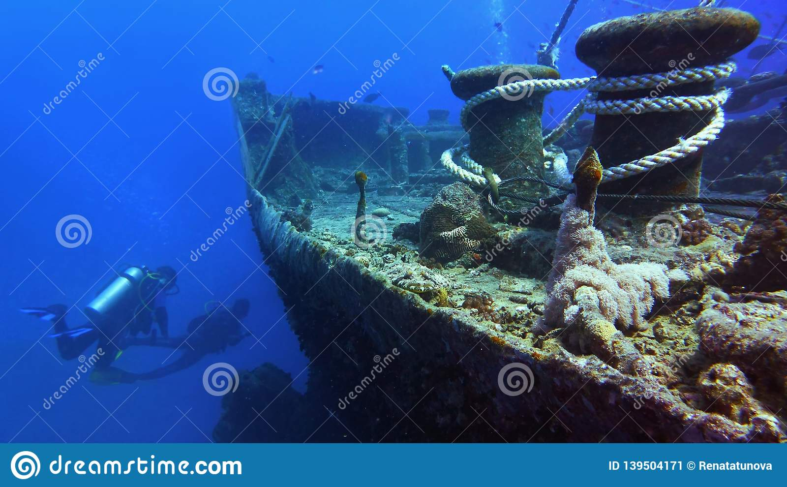 Shipwreck Thistlegorm and scuba divers on the background