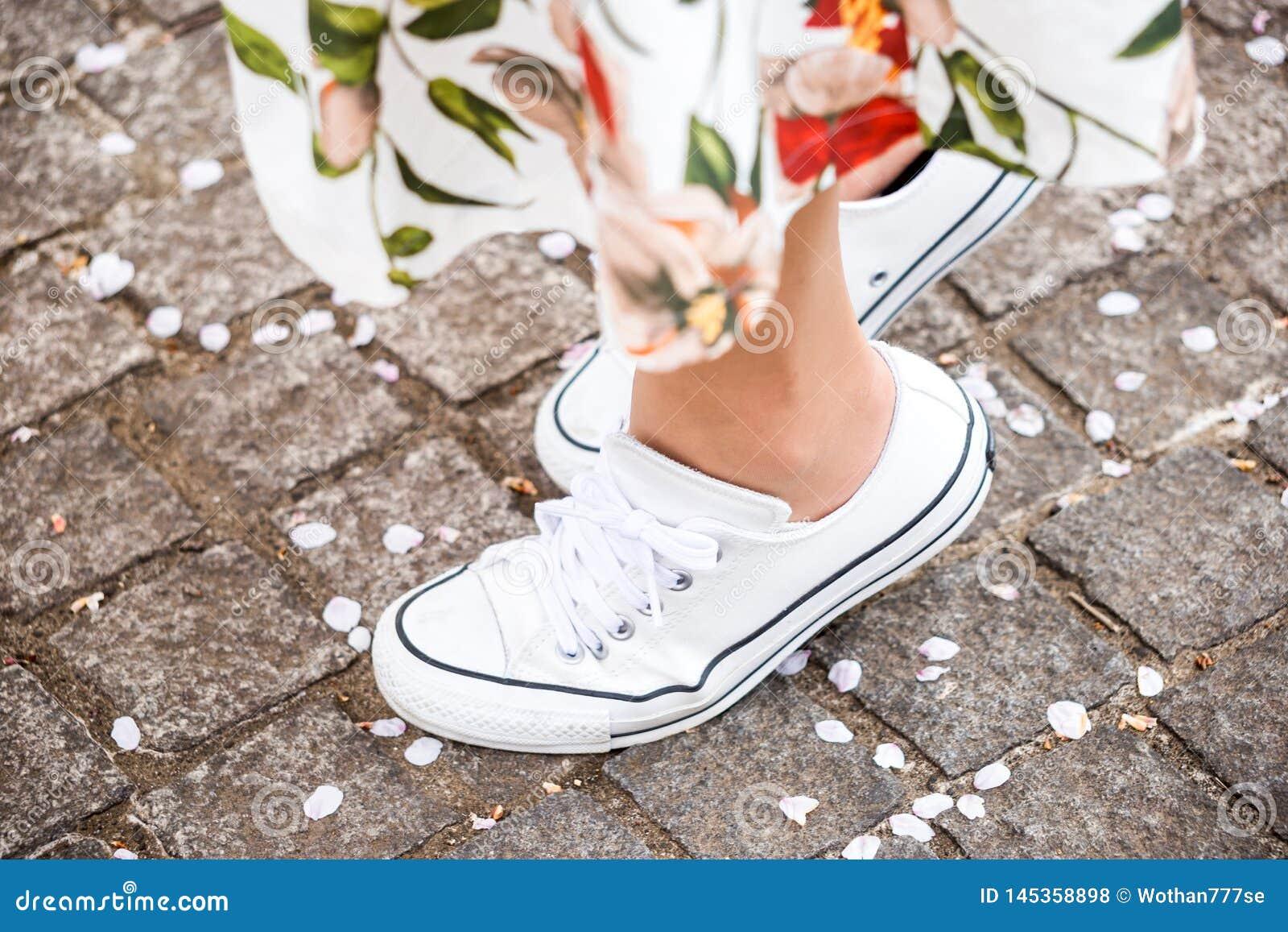 Woman standing on tiptoes