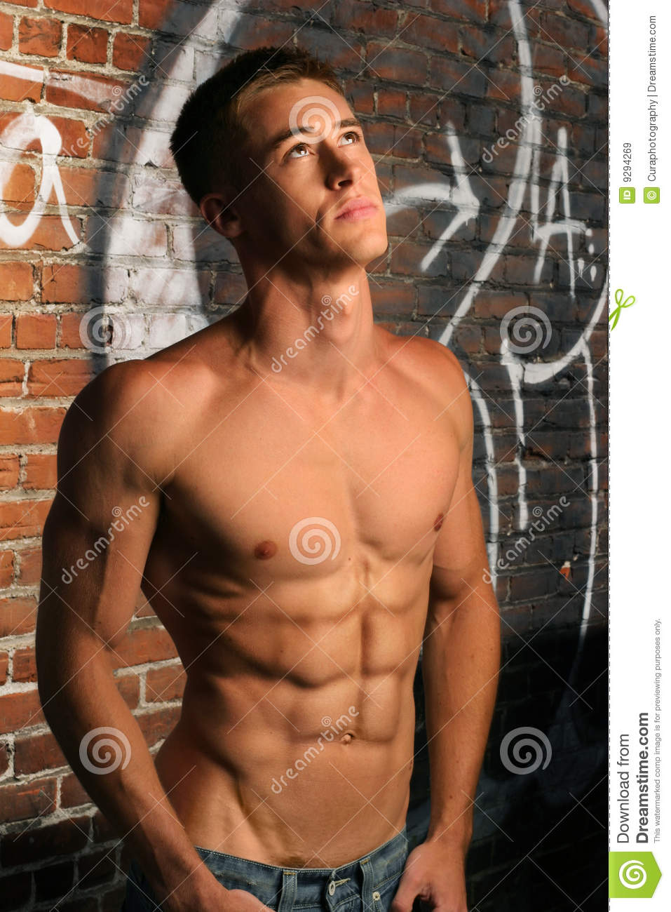 Shirtless Guy Looking Up stock image. Image of abdominals