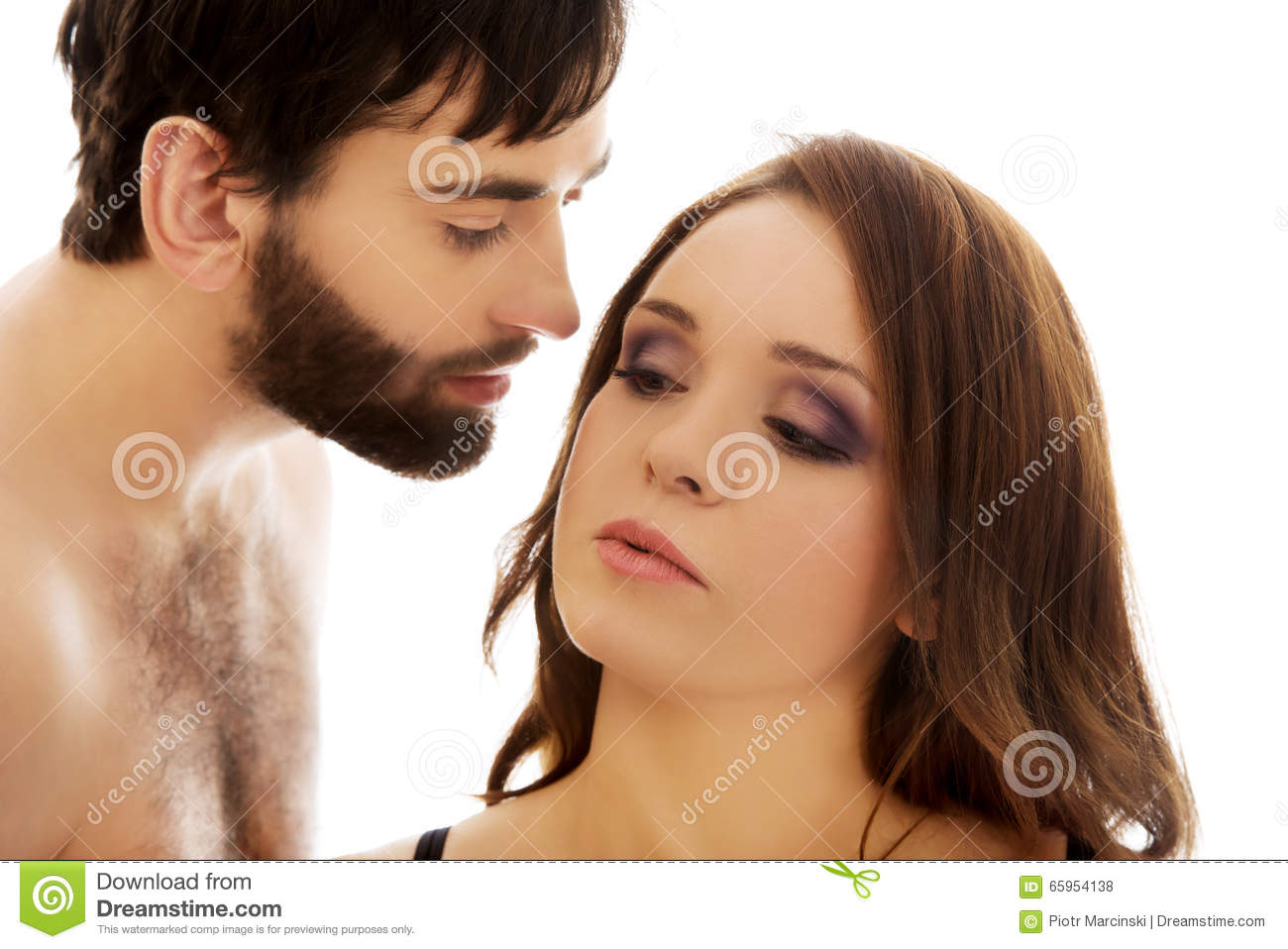 shirtless man whispering to womans ear stock photo
