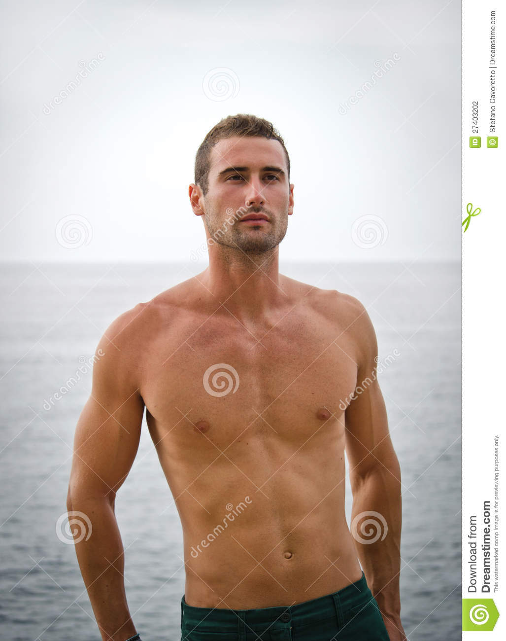 More similar stock images of ` Shirtless muscular male model with sea ...