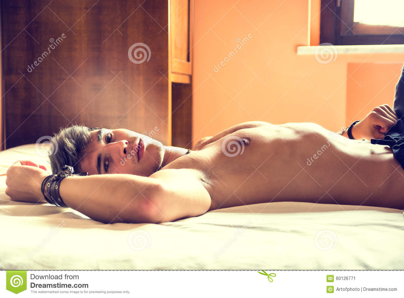 Boy naked in bed