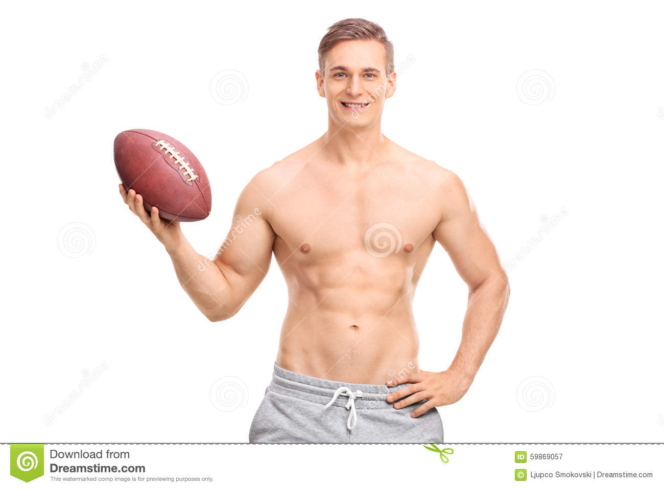 Shirtless young man holding a football