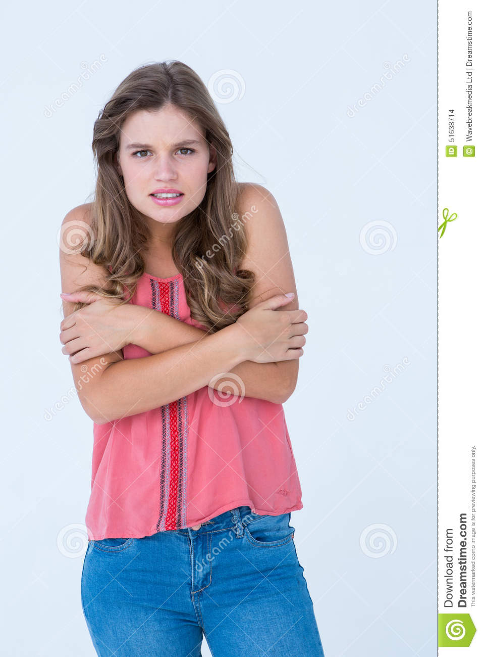 shivering woman holding her arms stock photo image of clothes