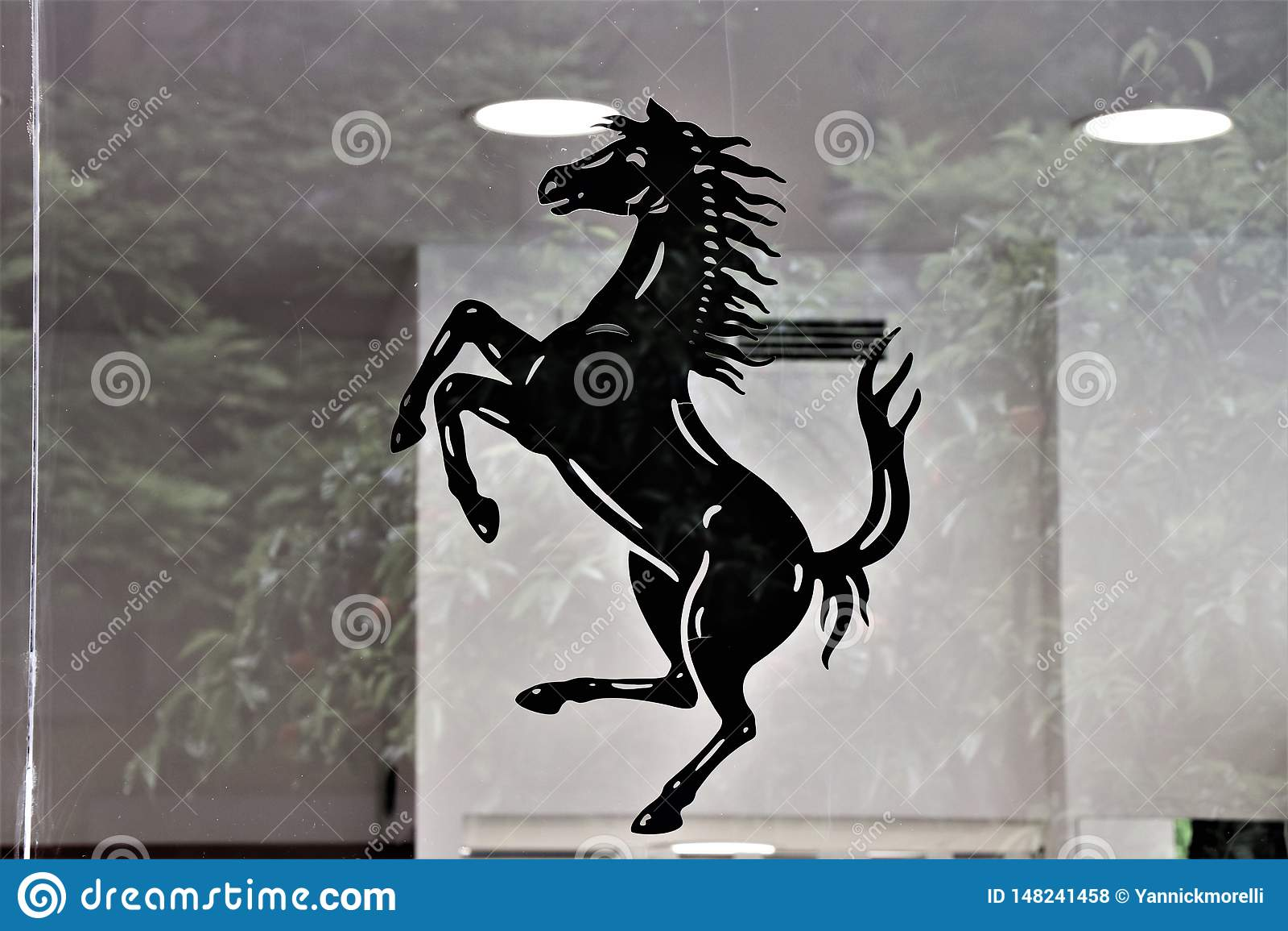Symbol Of The Ferrari And Showcase Of A Ferrari Store Editorial Stock Photo Image Of Accessories Clothes 148241458