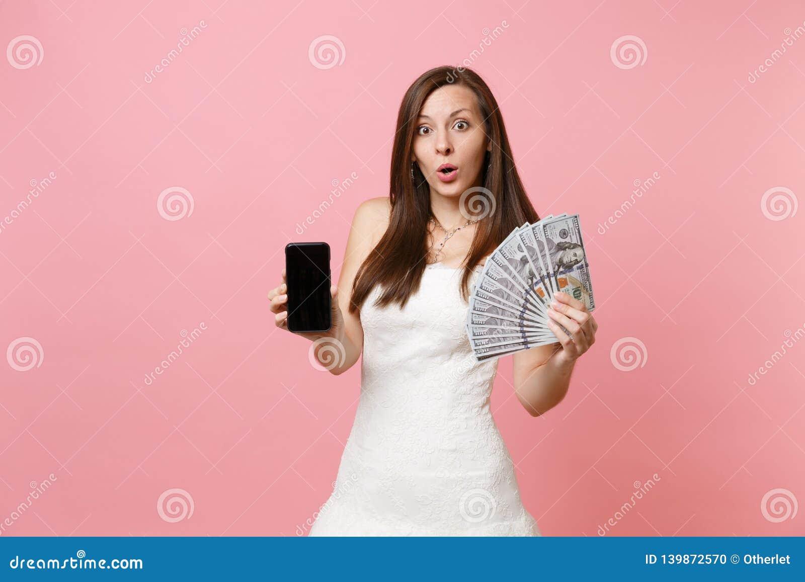 Shocked Bride Woman In Wedding Dress Holding Bundle Lots Of Dollars