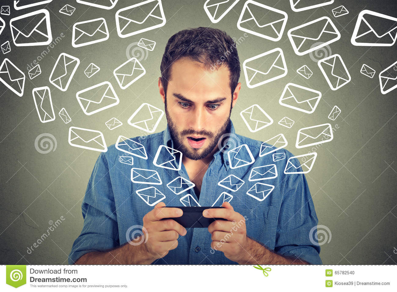 Shocked man busy sending messages emails from smart phone email icons flying of mobile phone