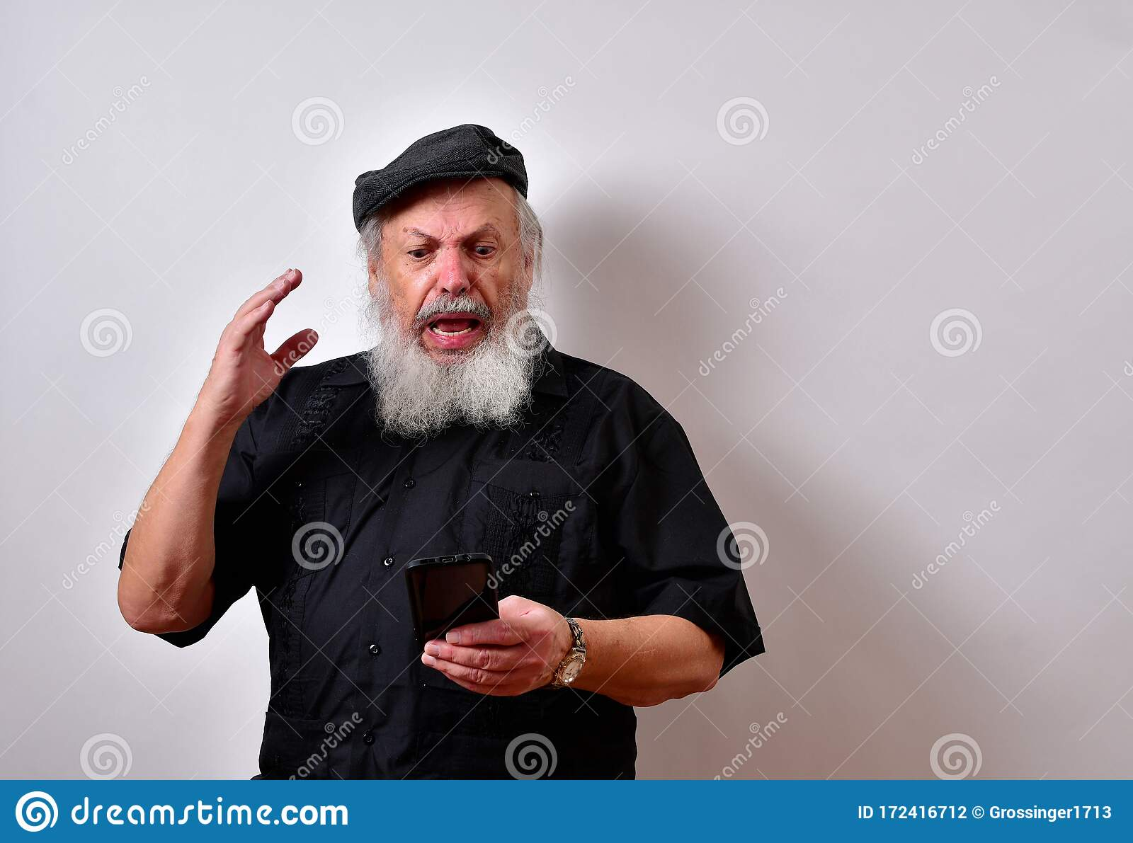 Shocked Old Man Looks At His Cellphone Stock Photo Image Of