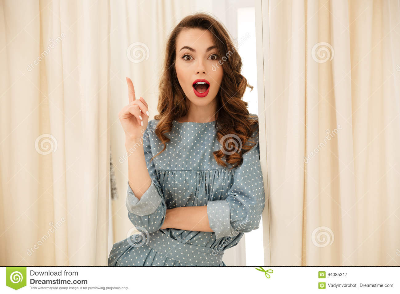 Shocked young lady standing in fitting room