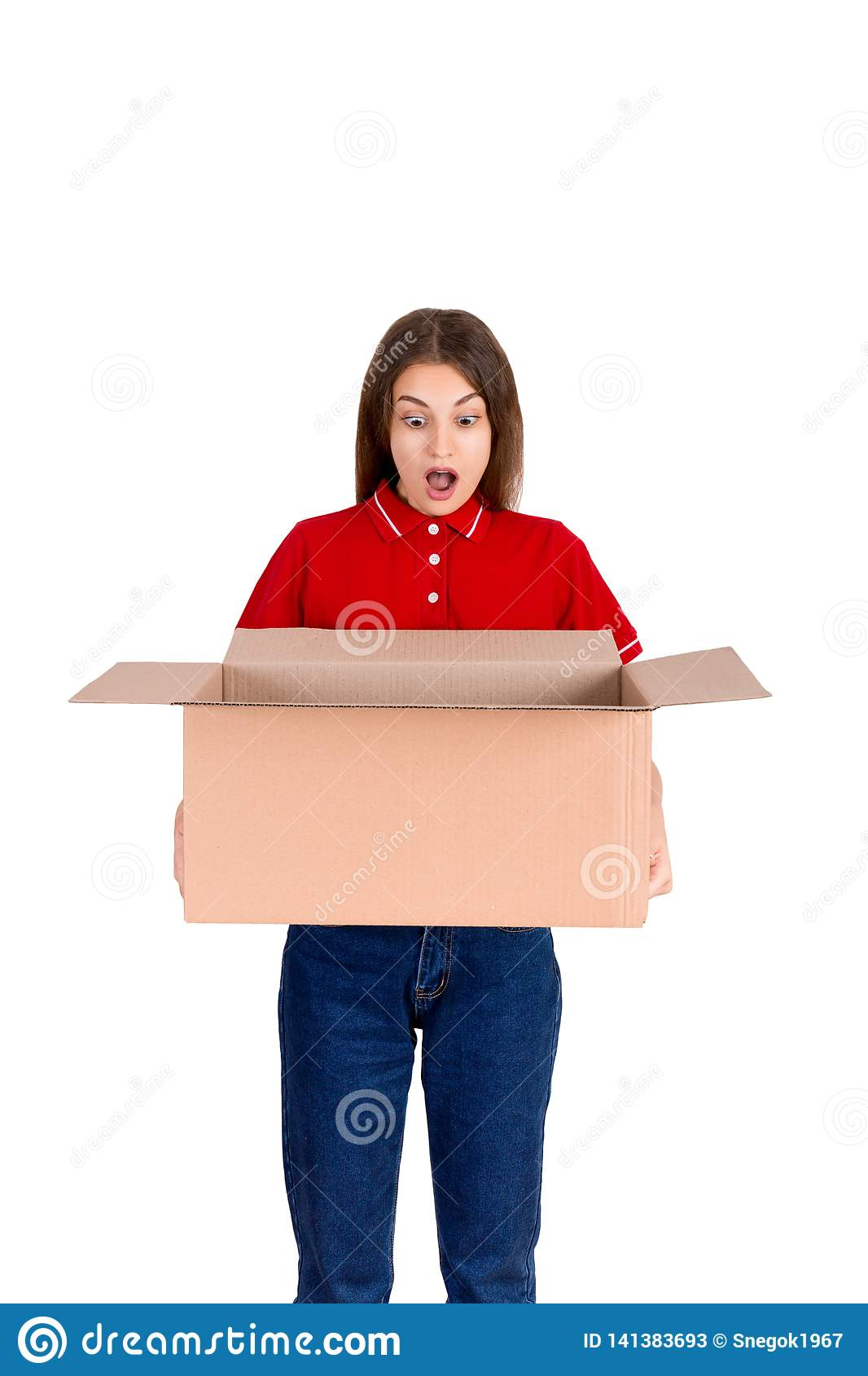 Shocked young woman is looking at missed parcel from the box isolated on white background