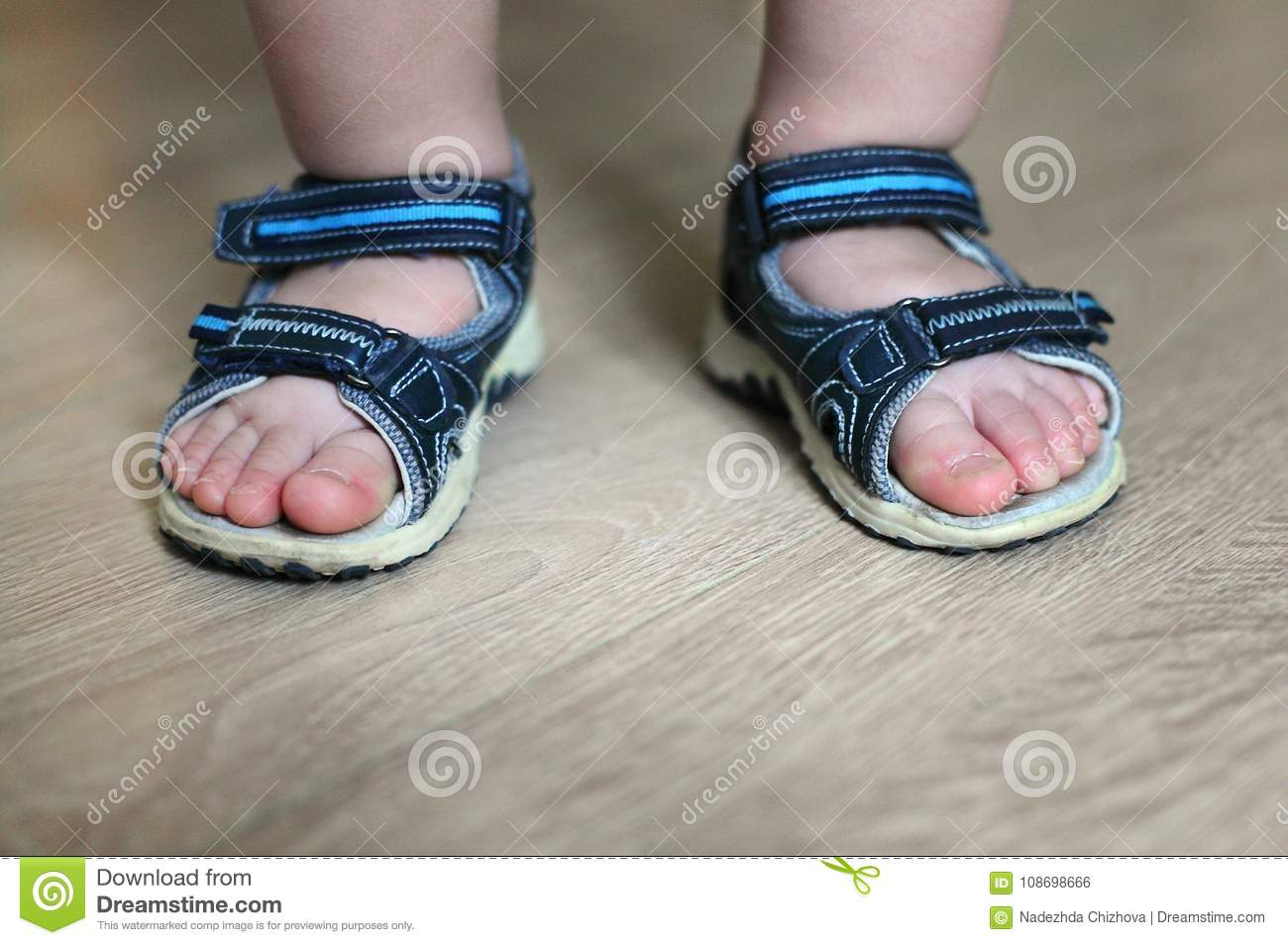 962b55b247e Children`s sandals on their feet. Toddler shoes. Tourist sandals for the  smallest travelers. A new purchase in a shoe store.