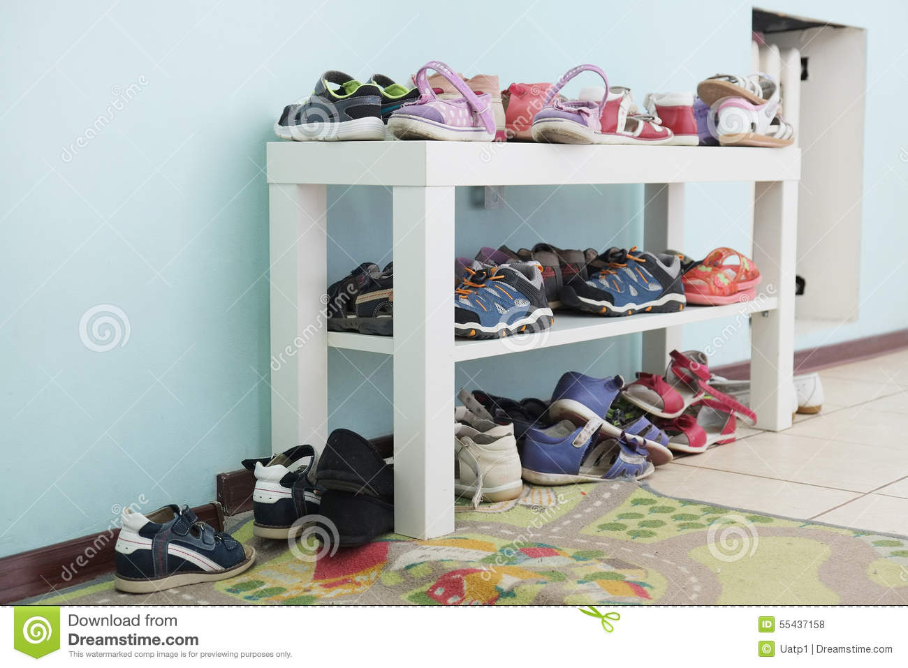 Shelf Of Children Shoes For All Seasons Isolated Stock ...