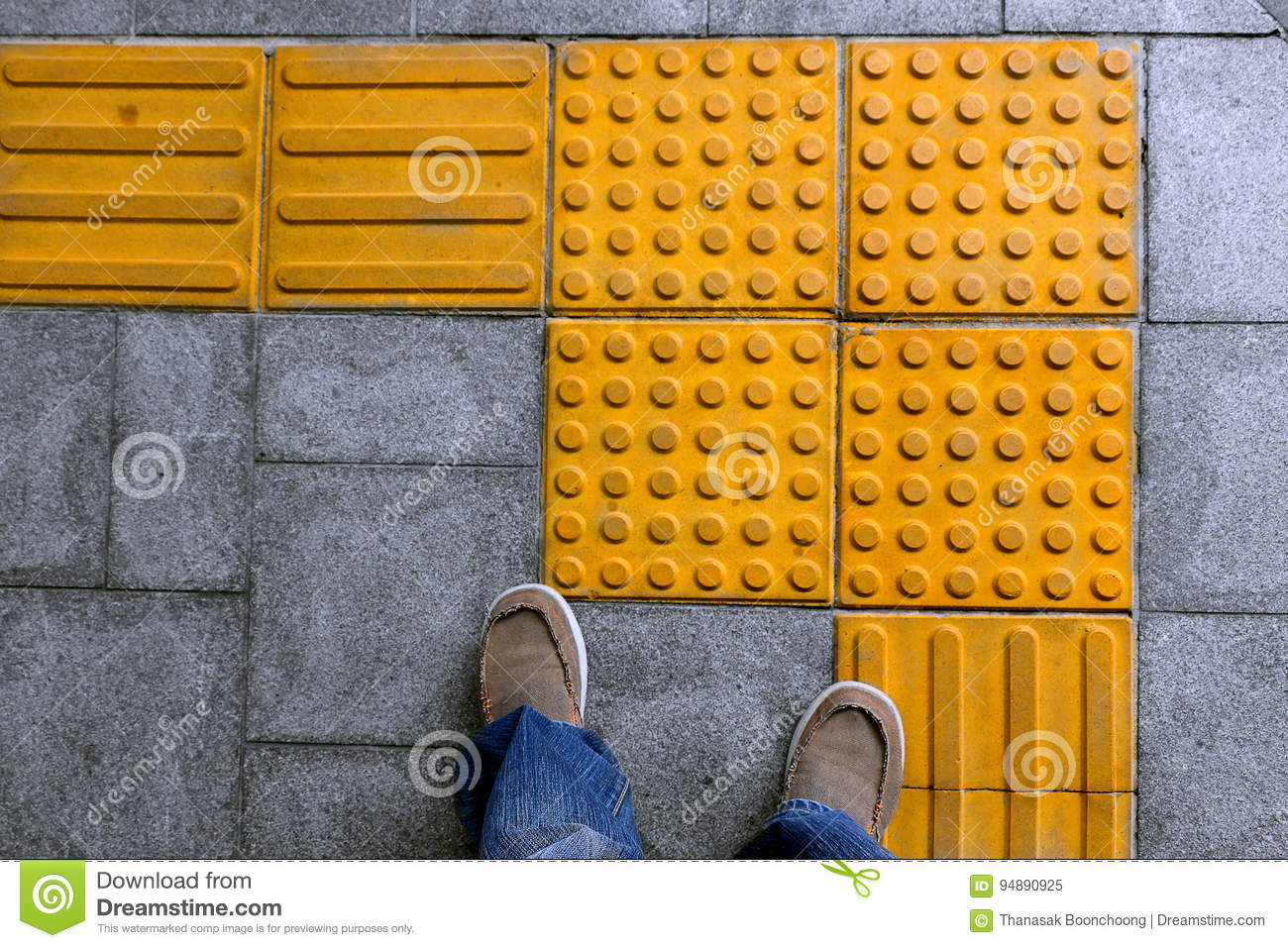 Shoes on block tactile paving for blind handicap stock image royalty free stock photo dailygadgetfo Image collections