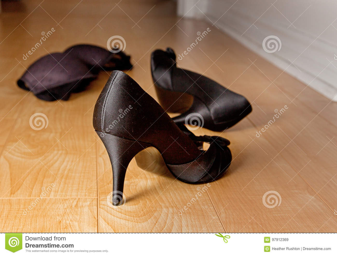 Lust Or Passion, With High Heeled Stilhetto Shoes And A Black Bra Thrown On  The Bedroom Floor