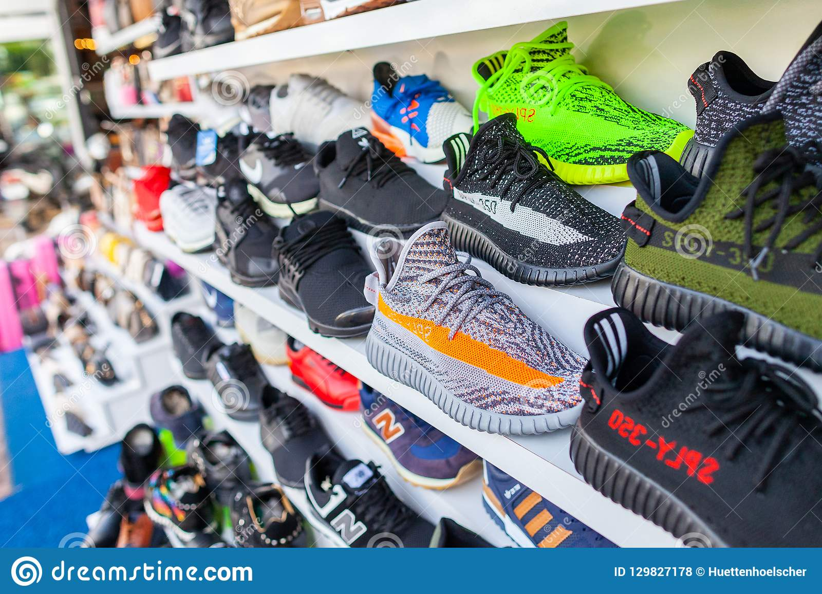 99c5c5e3685a Shoes Of Different Brands Stands In A Shop Editorial Stock Photo ...