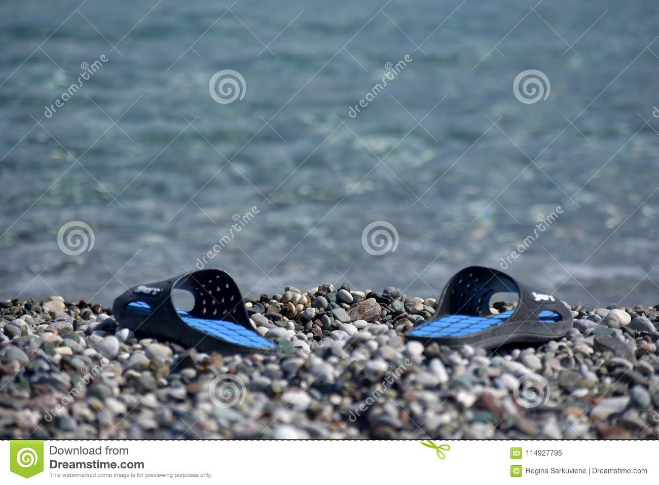 0398f9d20 Shoes in empty beach stock image. Image of holidays - 114927795