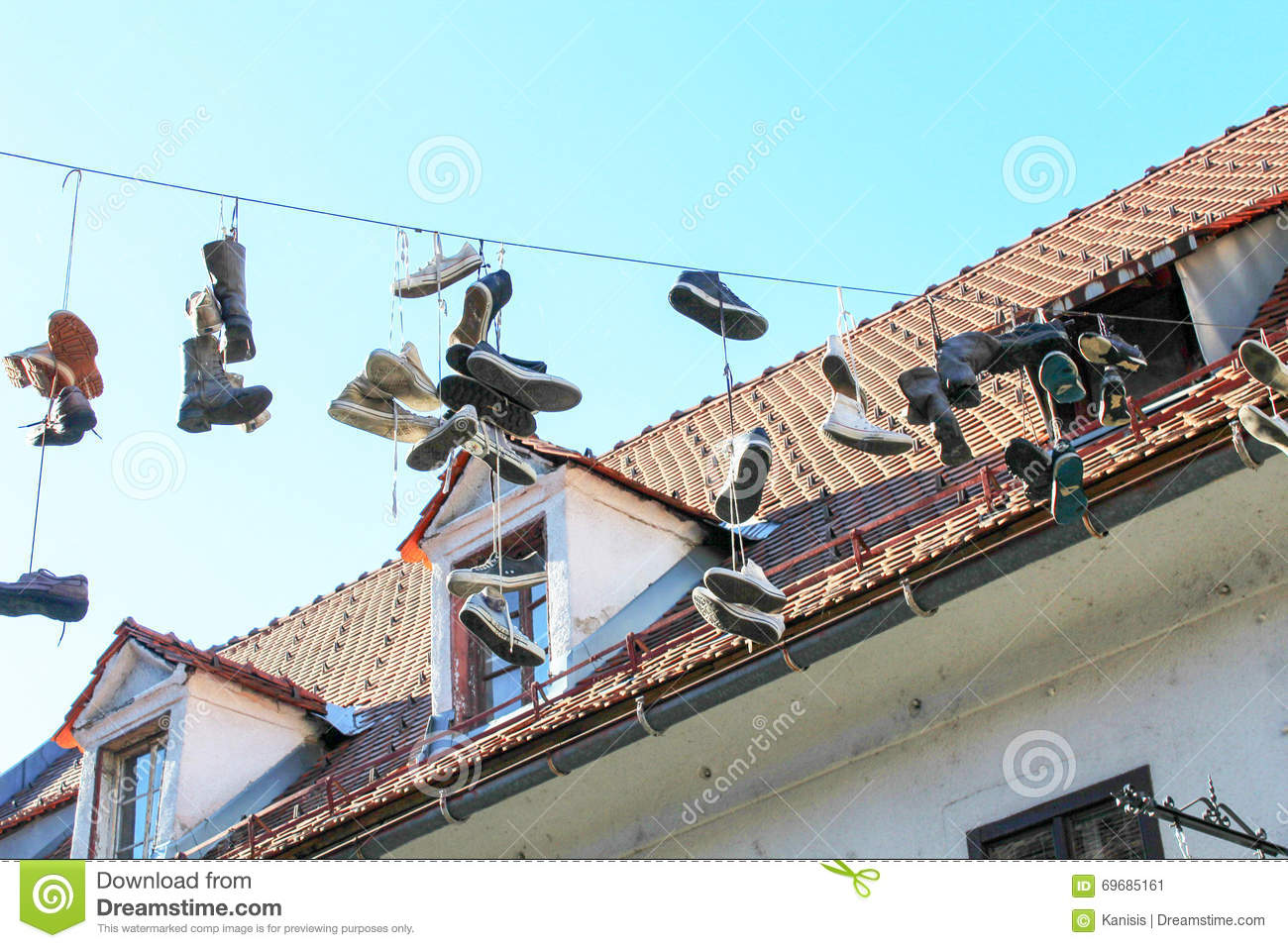 Shoes Hanging By Shoelaces On A Wire Stock Photo 69685161