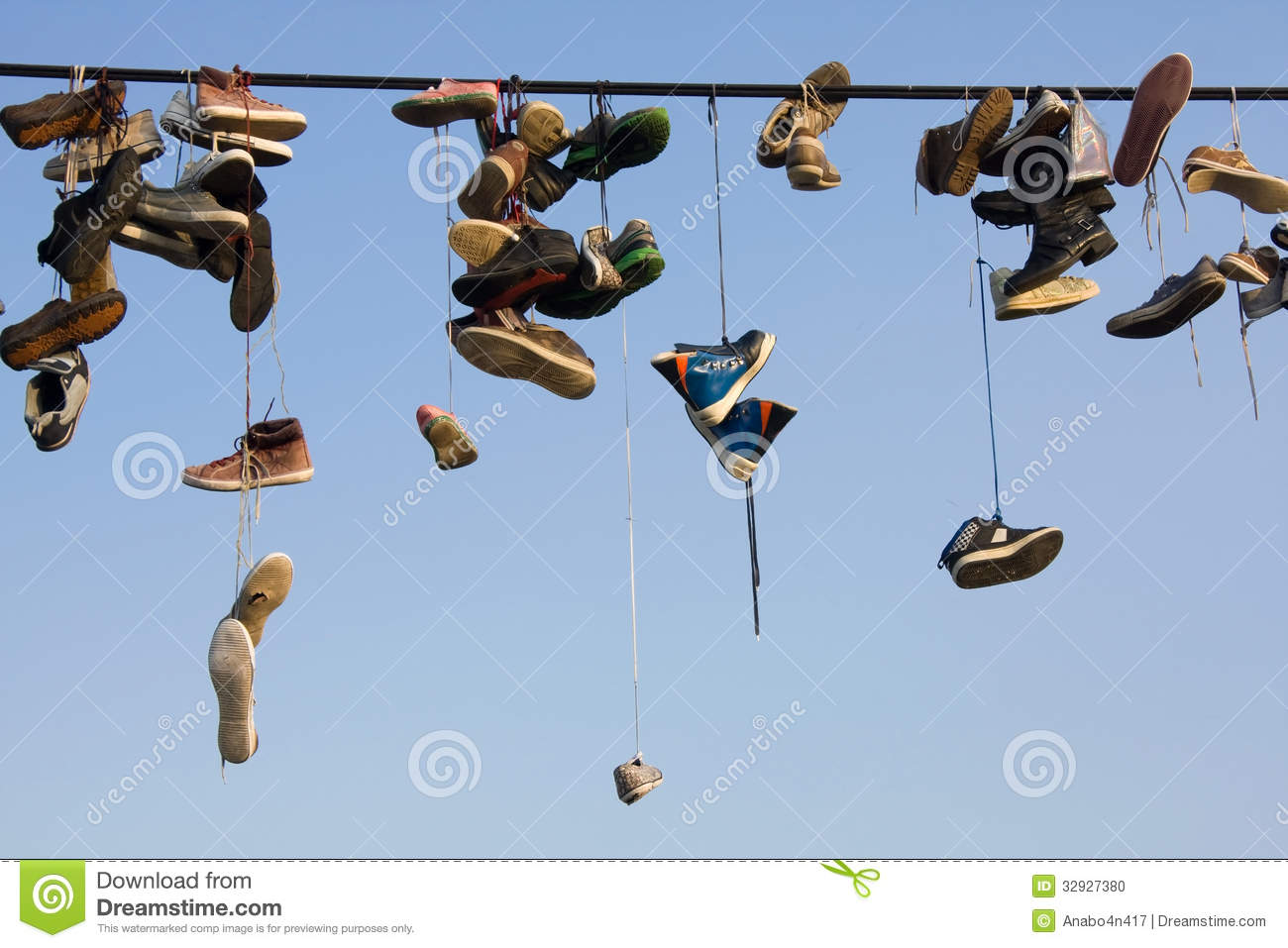 Hanging Photos On Wire old shoes hanging on a wire stock photo - image: 43231008