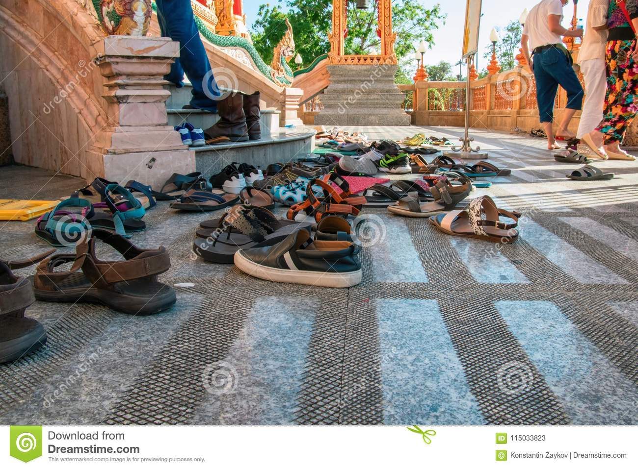 Shoes left at the entrance to the Buddhist temple. Concept of observing traditions, tolerance, gratitude and respect.