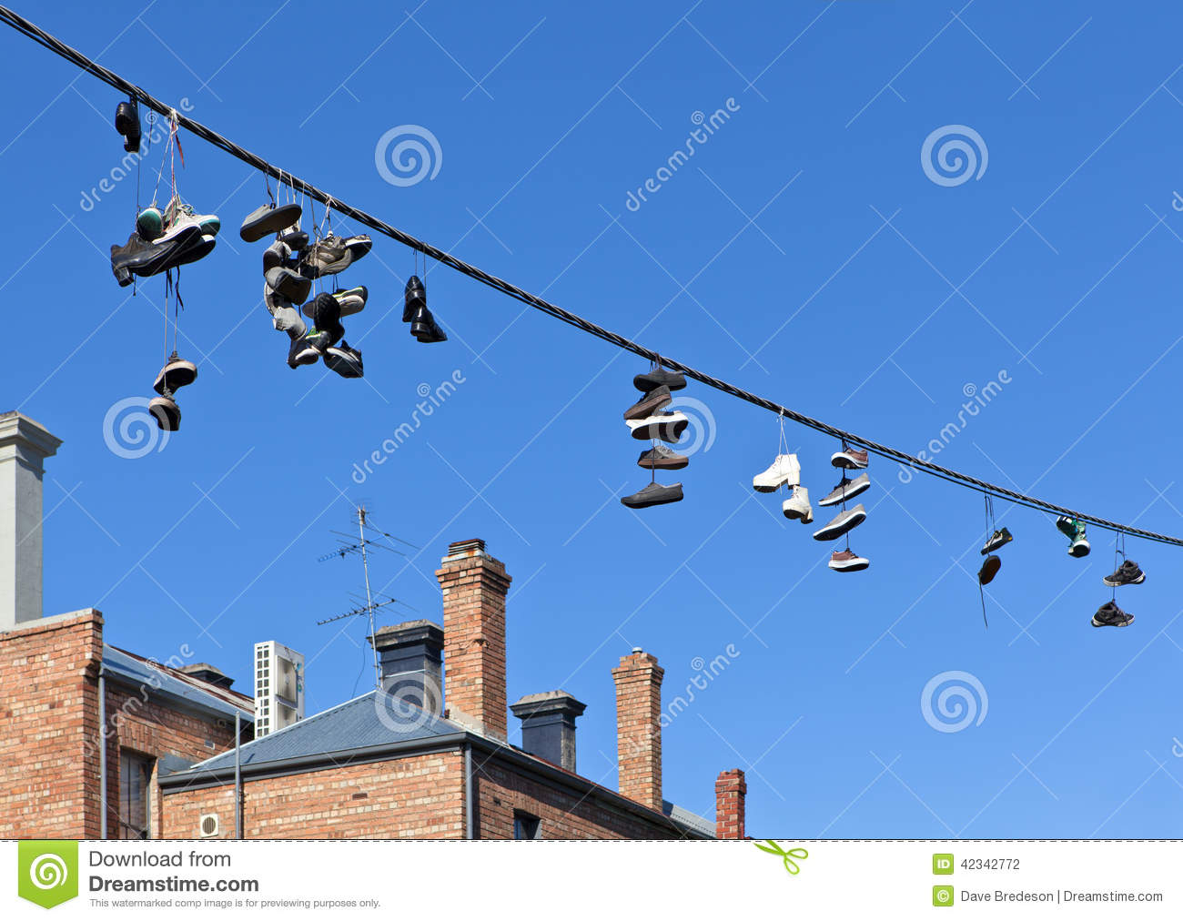 Shoes On Telephone Wire Stock Photo  Image Of Pairs  Tied