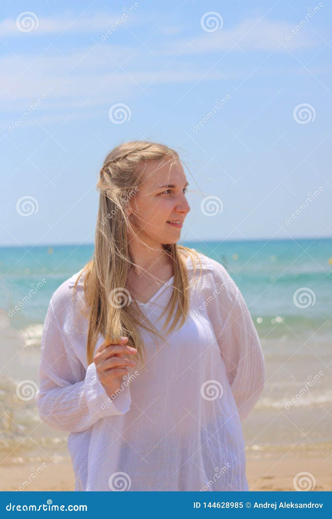 Blonde woman outdoor beach