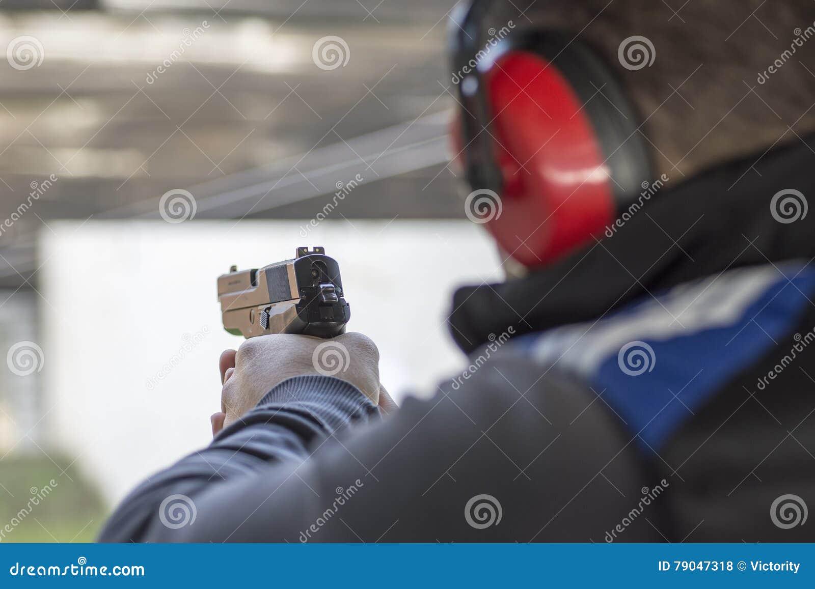 man shooting pistol sideview stock photo cartoondealer