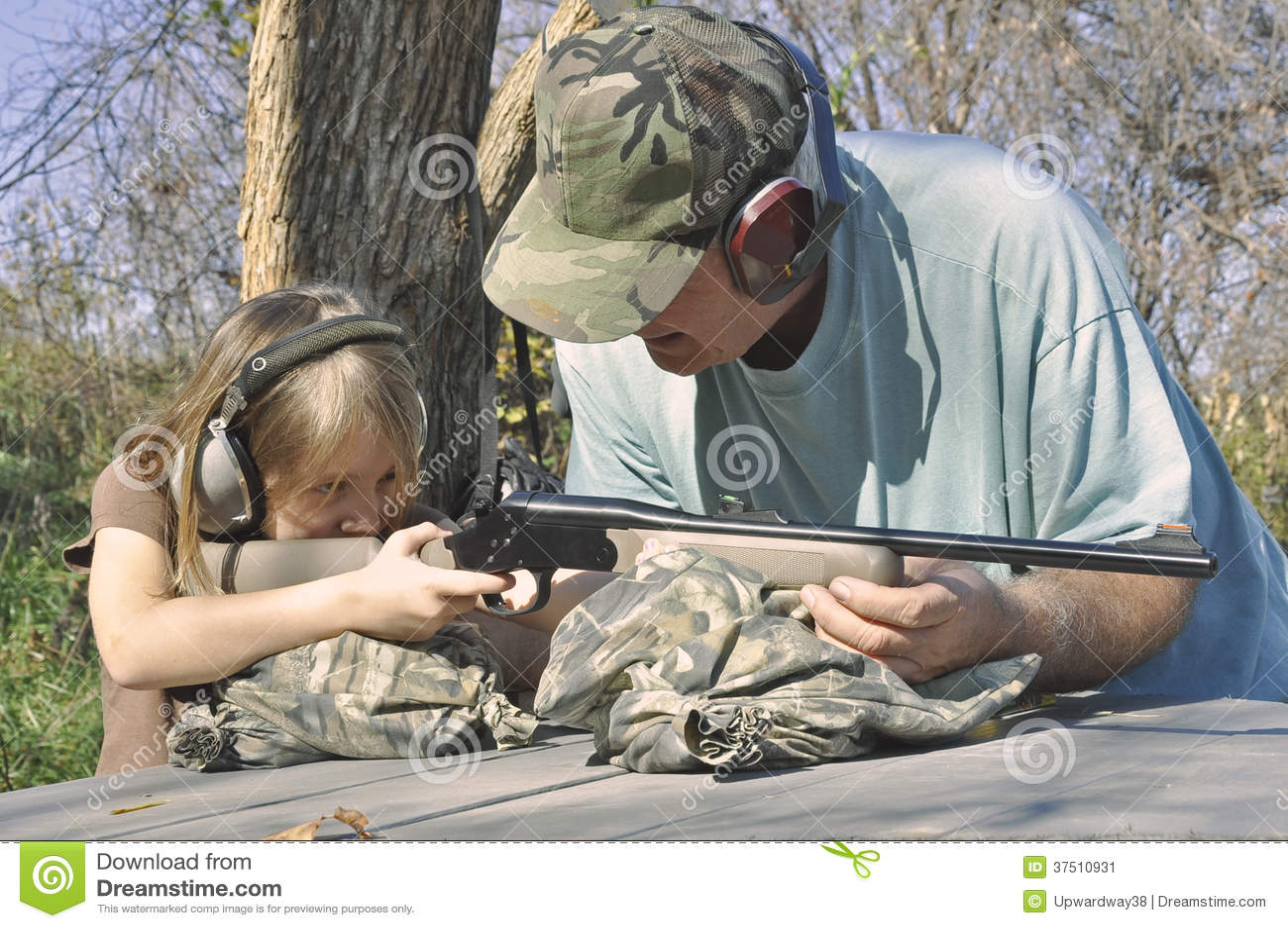 Man Teaching Girl To Shoot Stock Image Image 37510931