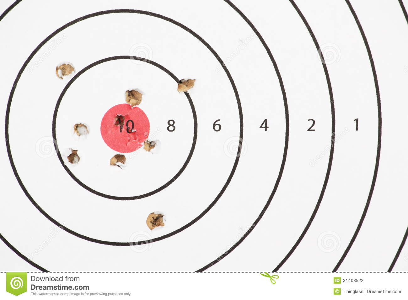 Close up of a shooting target with a red bullseye and bullet or pellet