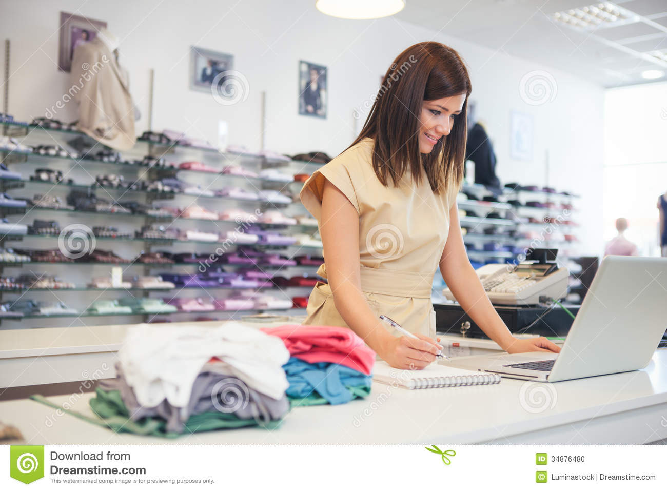 shop assistant at a clothes store stock photo image  shop assistant at a clothes store