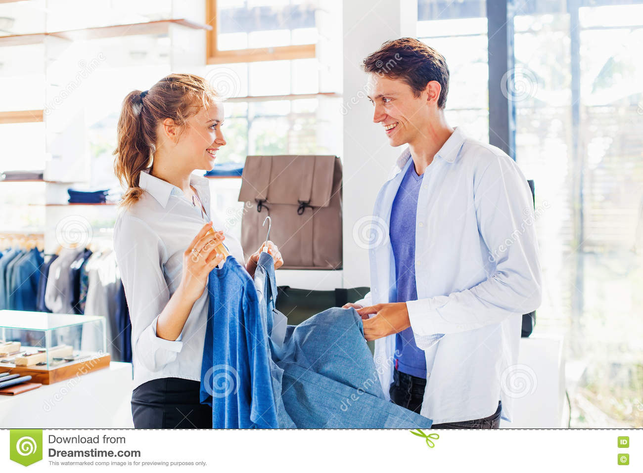 shop assistant helping to choose clothes stock photo image  shop assistant helping to choose clothes