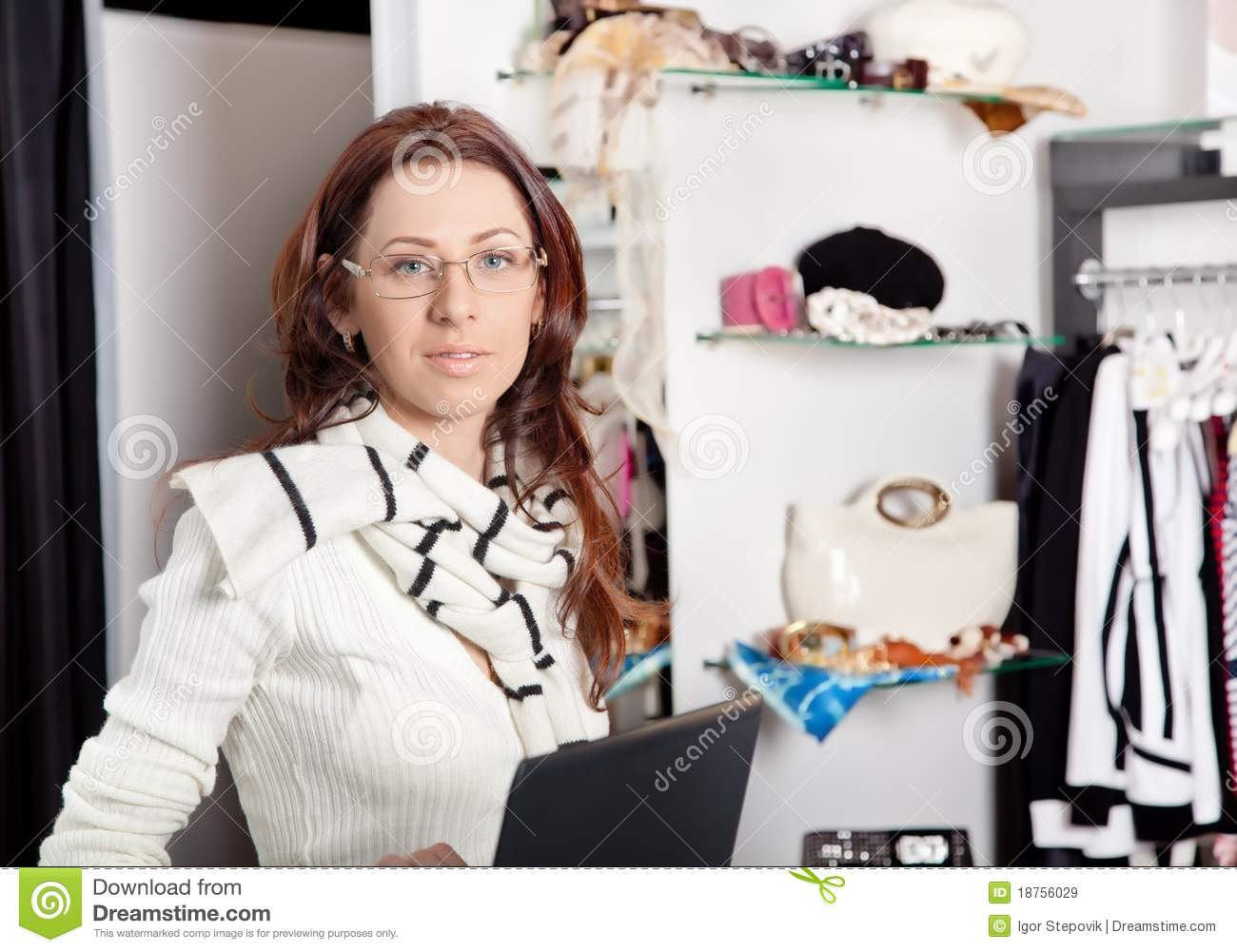 shop assistant at a clothes store stock photo image  shop assistant laptop working in store royalty stock images