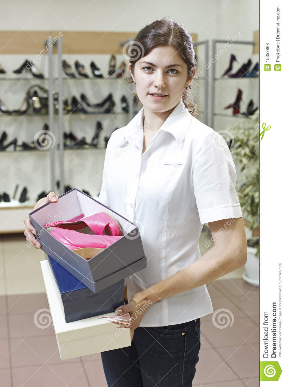 shop assistant in shoe store royalty stock photos image shop assistant in shoe store
