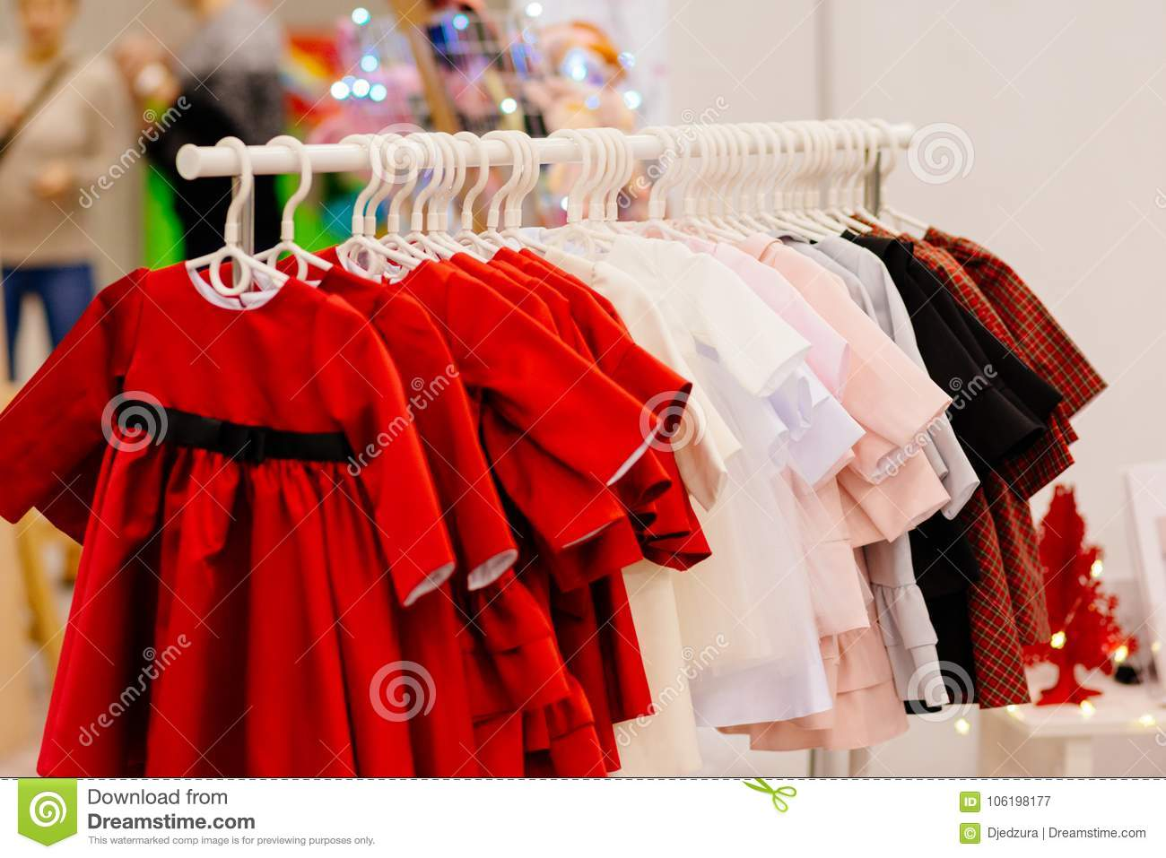 aed864011 Shop Hanger With New Girls Dresses In Fashion Store. Stock Image ...