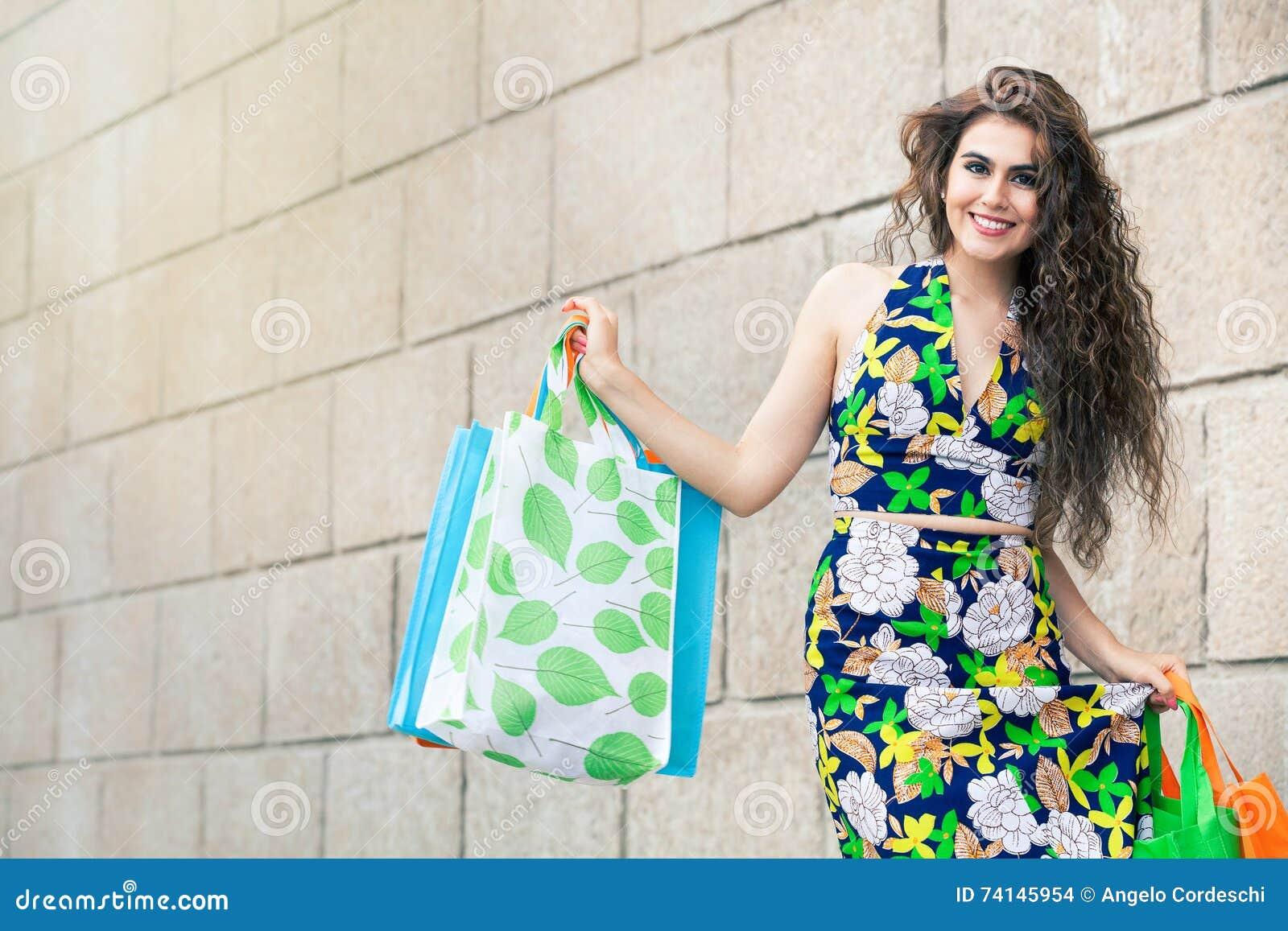 Shopaholic. Shopping love. Beautiful happy woman with bags.