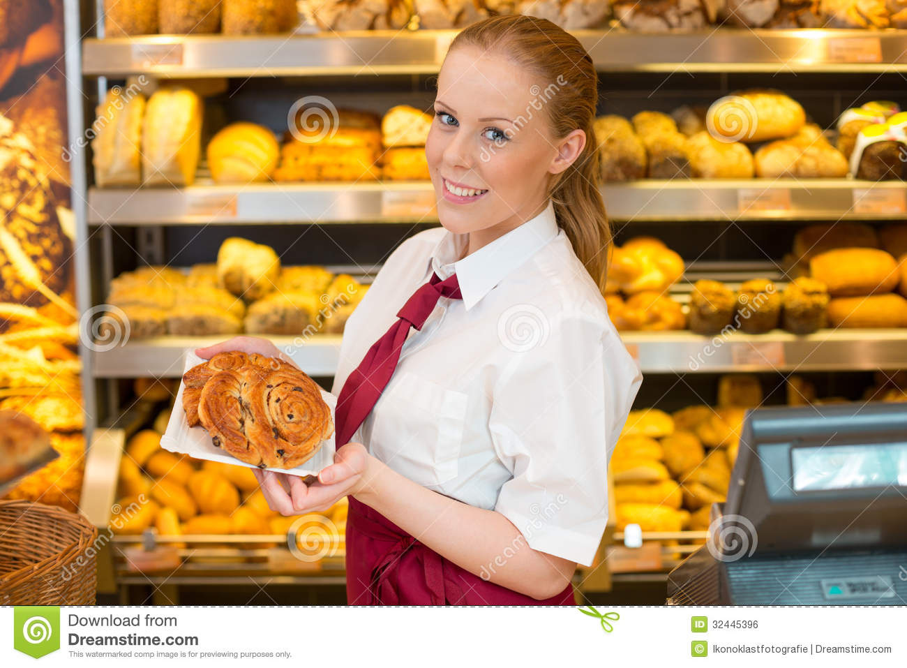 Shopkeeper In Bakery Giving Bread To Customer Royalty Free