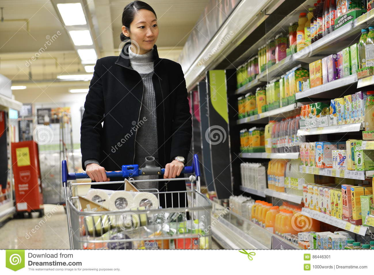 Shopper Browses A Supermarket Aisle Editorial Photo - Image of fast