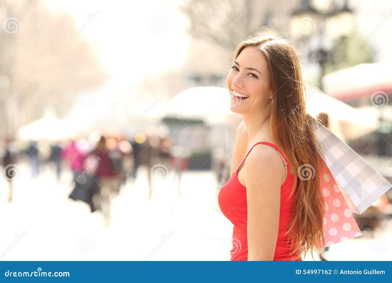 Shopper woman shopping in the street in summer