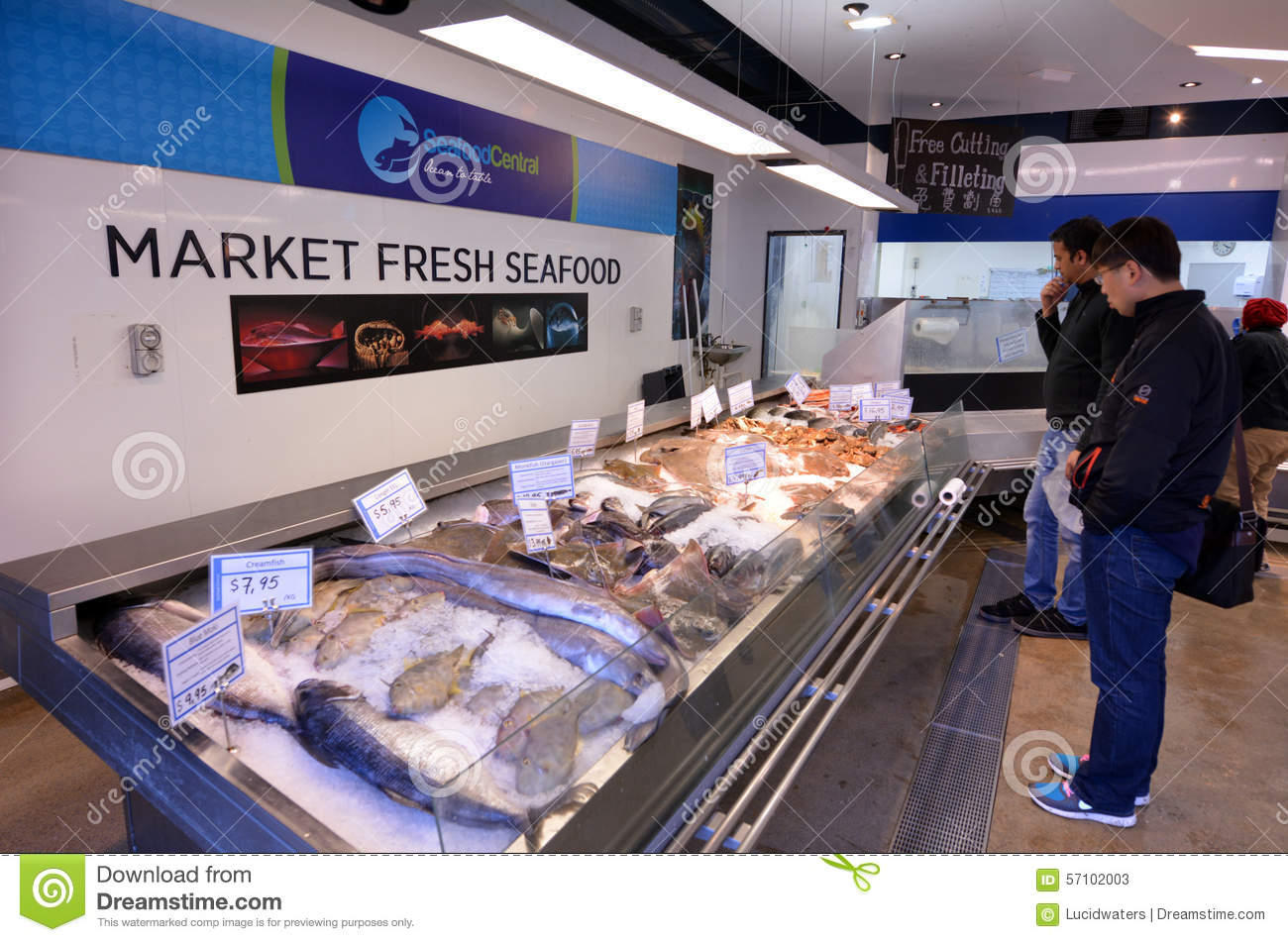 Shoppers in auckland fish market auckland new zealand for Fish market prices