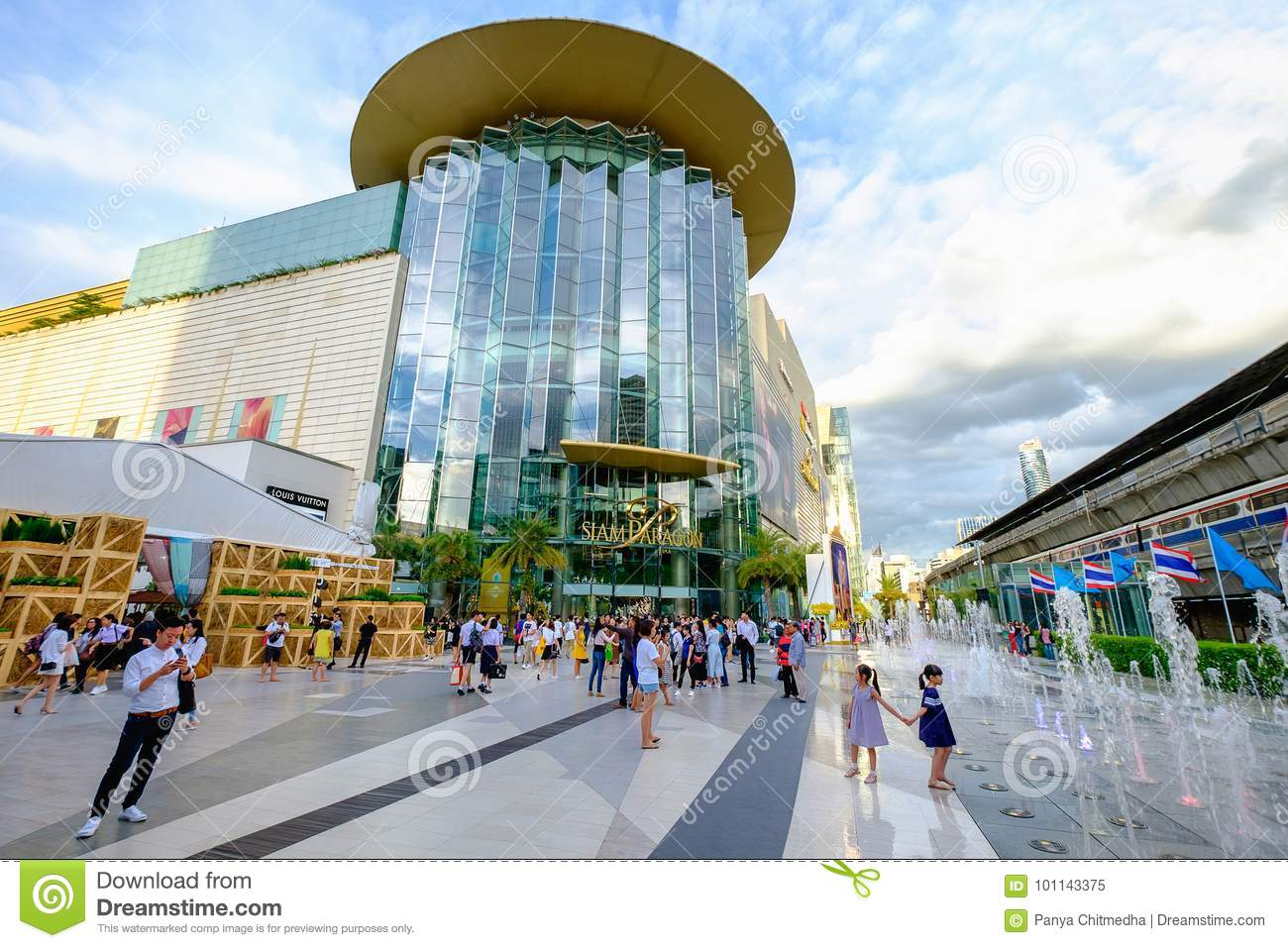 Shoppers visit Siam Paragon mall in Siam Square mall on in Bangkok, Thailand.