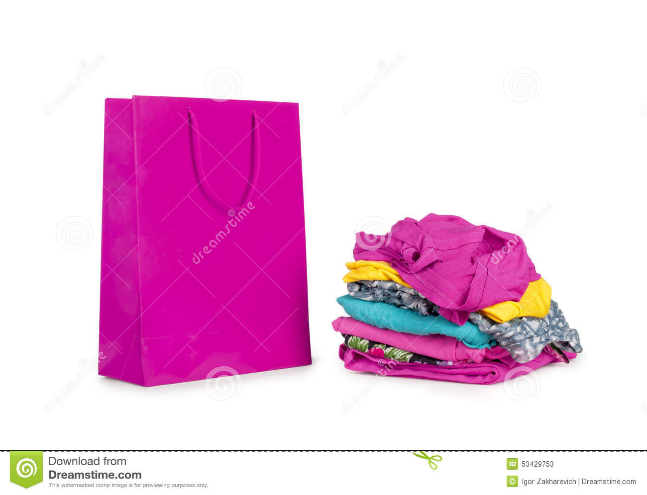 Shopping Bag And A Pile Of Clothes Stock Photo - Image: 53429753