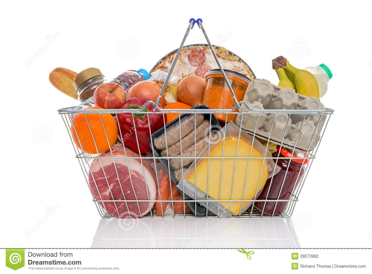 Shopping basket full of groceries isolated