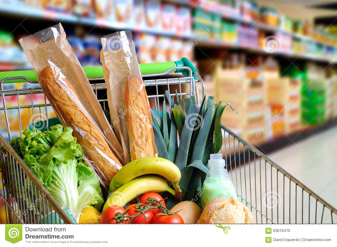 Shopping cart full of food in supermarket aisle elevated Shopping for home